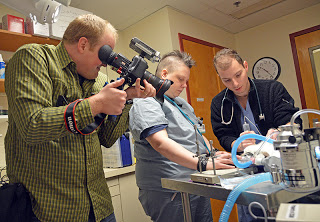 Tufts Multimedia Producer Steffan Hacker filming a veterinary procedure