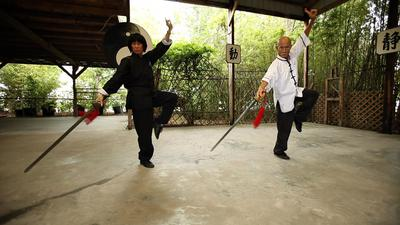 Grandmaster Chan and wife, Suzy Chan practice sword